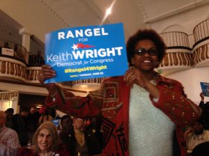 "A woman holds a ""Rangel for Keith Wright"" sign."
