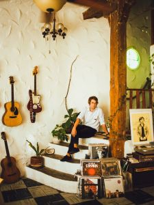 Kevin Morby at home, with his signature red guitar Dorothy at arm's reach