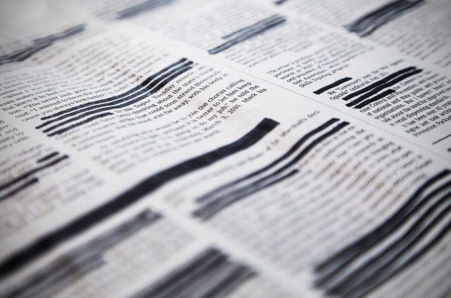 A redacted newspaper.