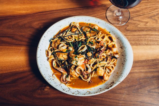 Taste the ocean in Herringbone's seafood spaghetti.