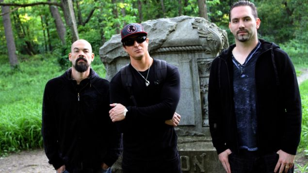 Former DJ Zac Bagans (center) flanked by the crew of Ghost Adventures.