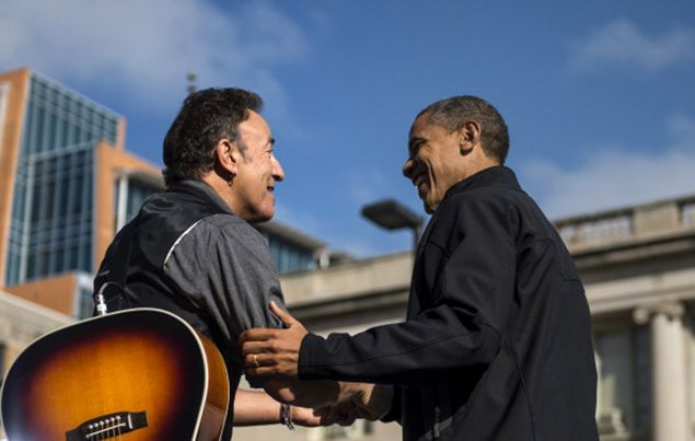 Bruce Springsteen shares a moment with President Barack Obama during a campaign stop in Madison, Wisconsin, on November 5, 2012.