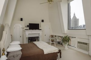 The attached studio is sans en-suite bath but with fireplace and sky-high ceilings.
