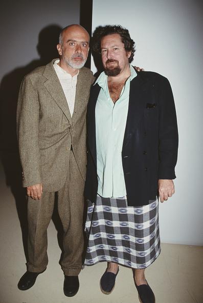 Italian artist Francesco Clemente (left) and American artist and filmmaker Julian Schnabel attending an art gallery party, USA, circa 2004.