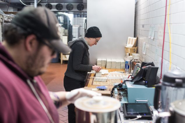 Labels being put on the chocolate bars at Cacao Prieto in red Hook, Brooklyn. 5/24/2016- Photo by Aaron Adler for The Commercial Observer