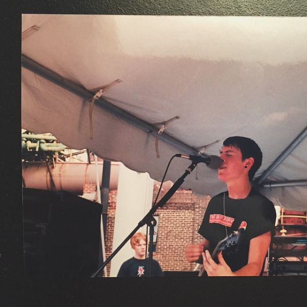 Ryan Burleson (foreground) playing with his band, Embraced, in 2002, with Aaron Gillespie (background) of Underoath watching from backstage.