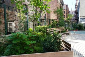 23888 Creston Avenue's courtyard boasts a performance space, bench seating and raised garden beds.