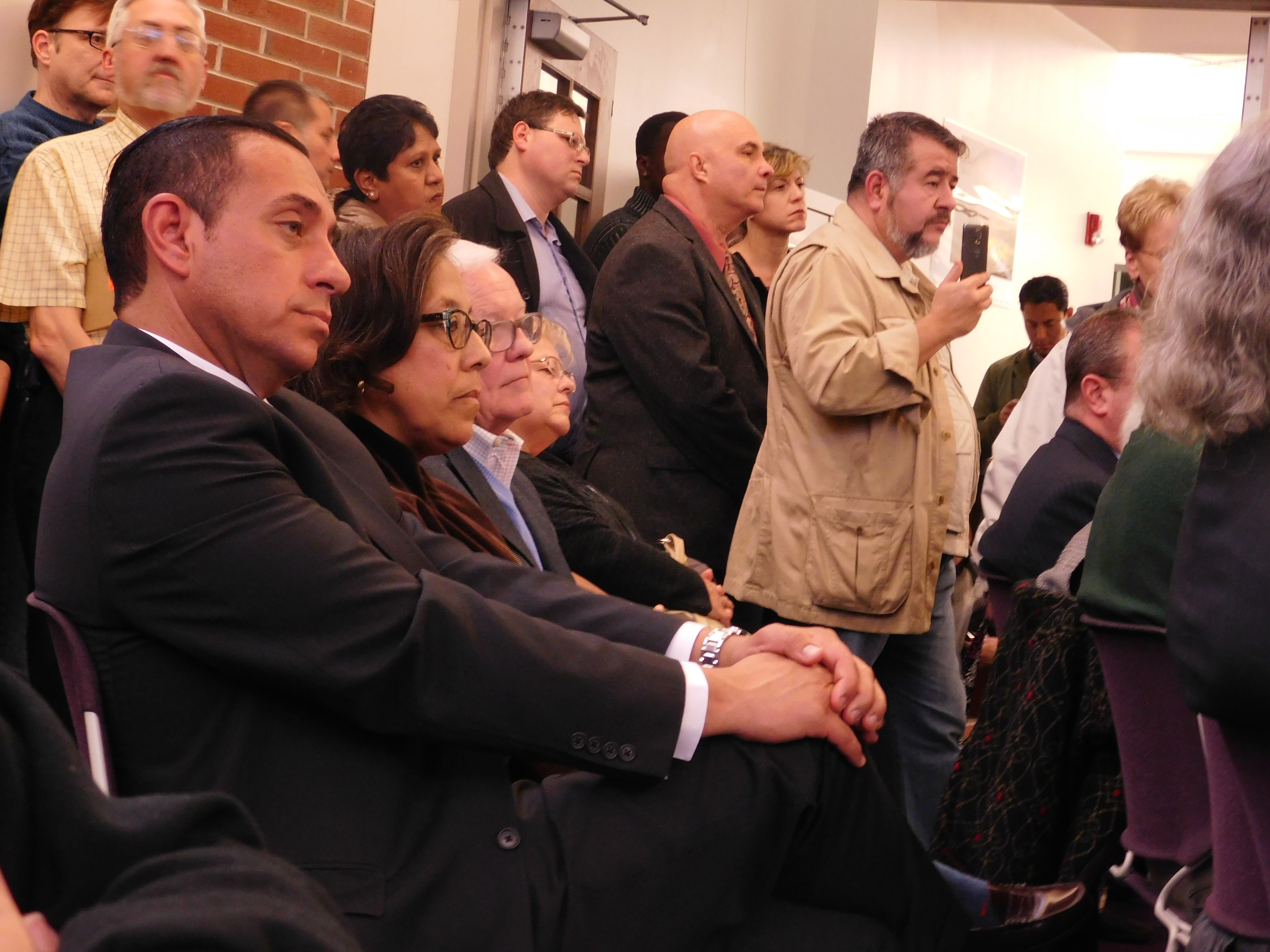 Lopez sits in the crowd at Venezia's meeting.