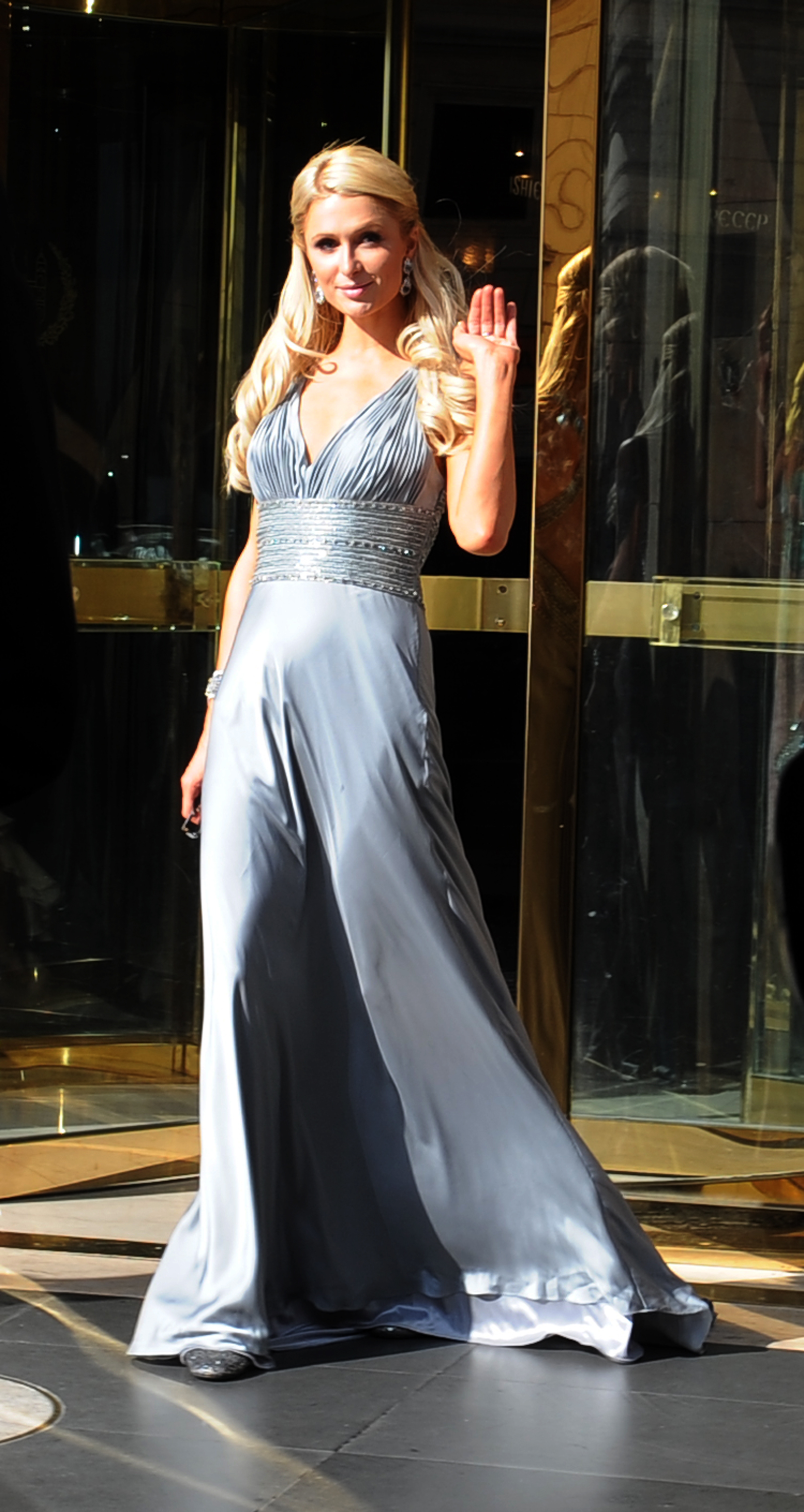 Paris Hilton leaves a hotel in central Rome to attend the wedding ceremony of Petra ecclestone, daughter of F1 chief Bernie Ecclestone, to wed James Stunt in the Odescalschi Castle in Bracciano near Rome on August 27, 2011. AFP PHOTO / Tiziana Fabi (Photo credit should read TIZIANA FABI/AFP/Getty Images)