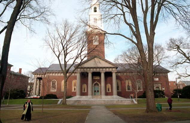 People walk around the Harvard University''s main campus December 19, 2000 in Cambridge, MA.