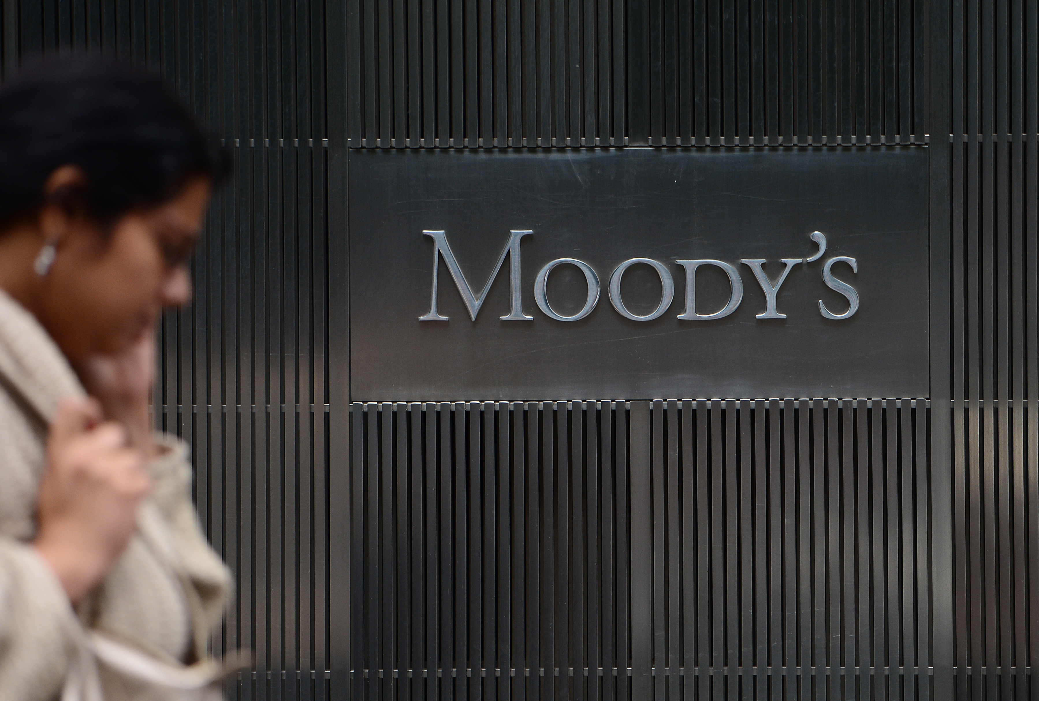 A sign for Moody's rating agency is displayed at the company headquarters in New York, September 18, 2012. AFP PHOTO/Emmanuel Dunand