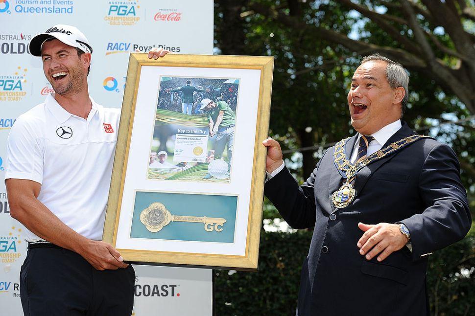 GOLD COAST, AUSTRALIA - NOVEMBER 06: Gold Coast Mayor Tom Tate presents Adam Scott of Australia the Key to the City at Royal Pines Resort on November 6, 2013 on the Gold Coast, Australia.