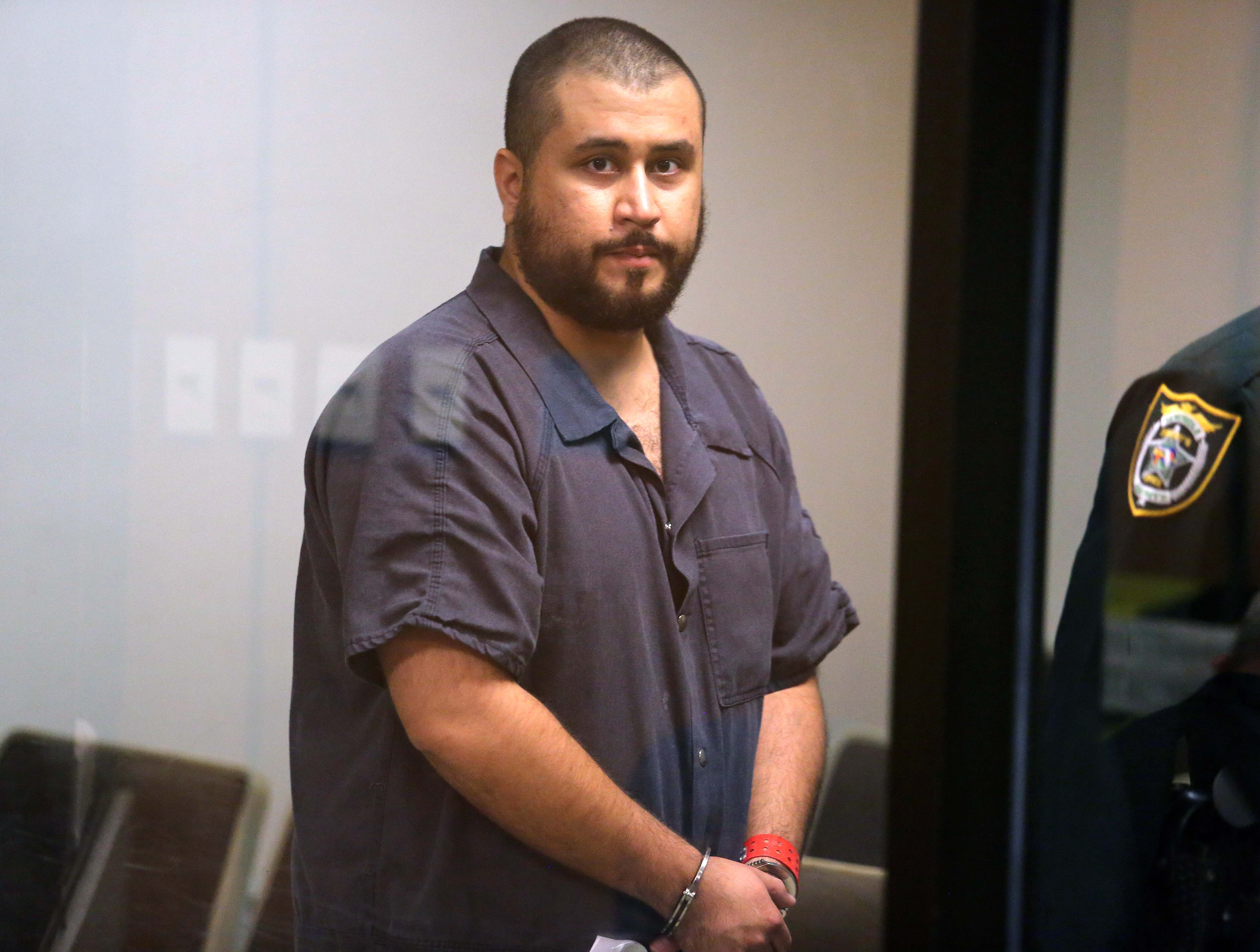 SANFORD, FL - NOVEMBER 19: George Zimmerman, the acquitted shooter in the death of Trayvon Martin, arrives in Courtroom J2 to face a Seminole circuit judge during a first-appearance hearing on charges including aggravated assault stemming from a fight with his girlfriend November 19, 2013 in Sanford, Florida. Zimmerman, 30, was arrested after police responded to a domestic disturbance call at a house. He was acquitted in July of all charges in the shooting death of unarmed, black teenager, Trayvon Martin.