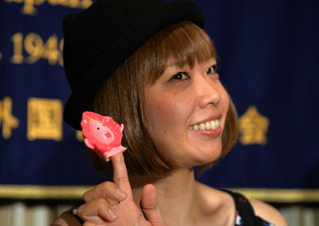 """Japanese artist Megumi Igarashi with one of her """"Manko-chan"""" sculptures."""