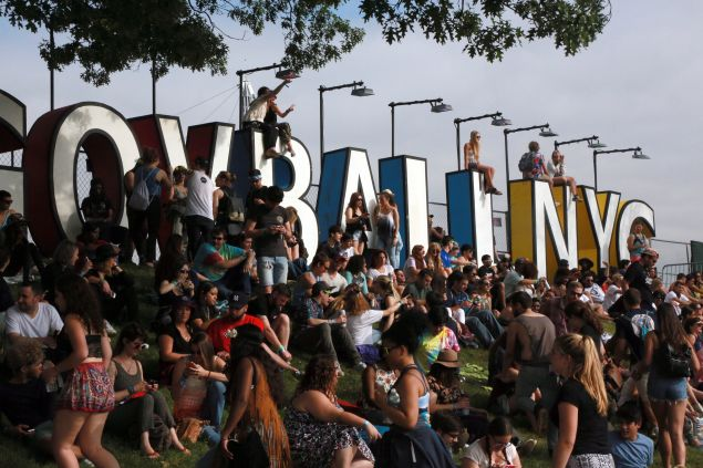 People climbed onto the signage for a better view during the Governors Ball Music Festival on Randall's Island Park in New York, on June 5, 2015.