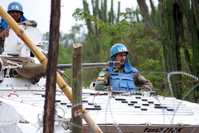 Indian peacekeepers of the Monusco, the UN mission in DRC, patrol on March 11, 2014 on a road near Tongo, some 45 km north of Goma.