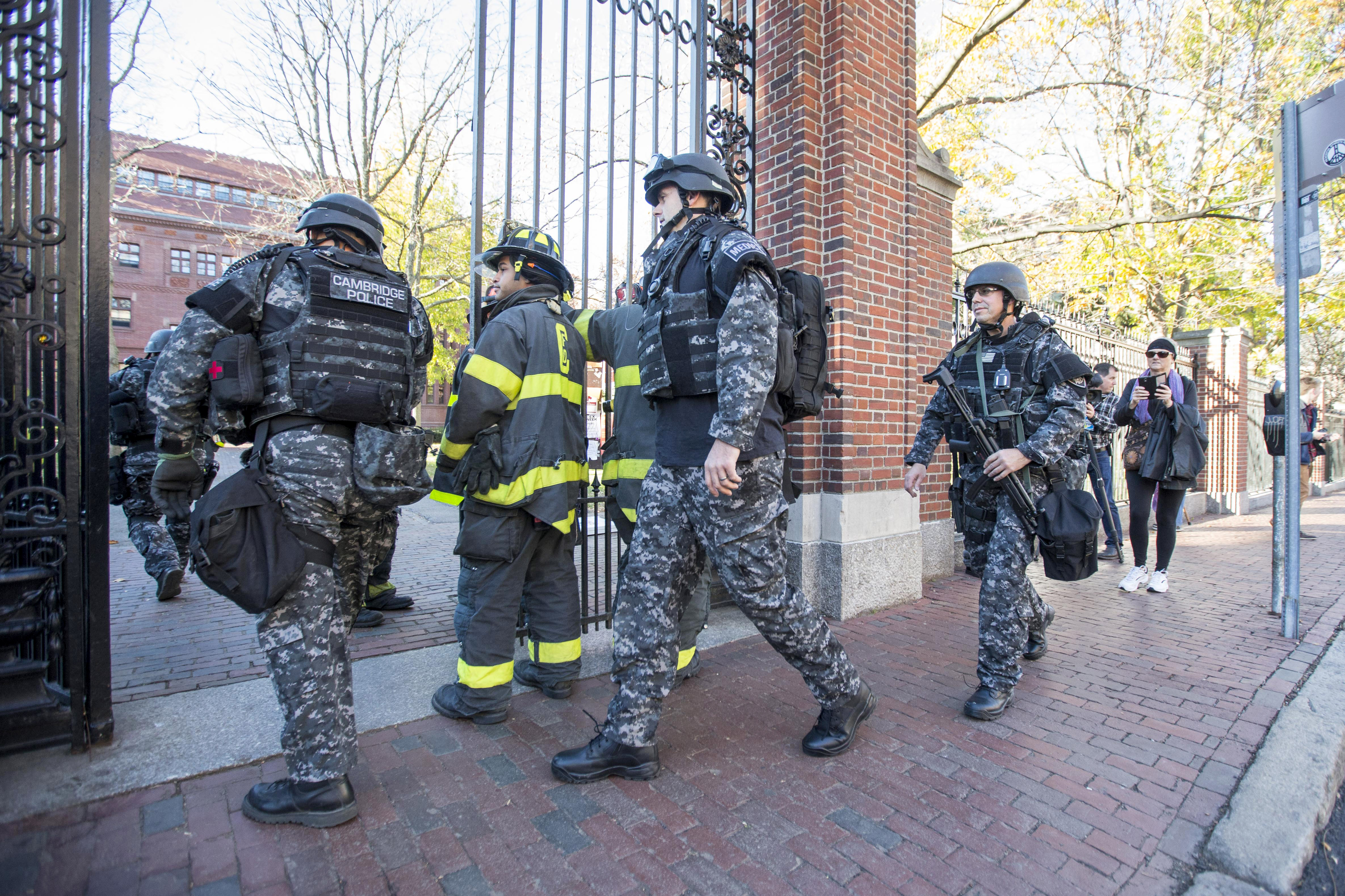 Cambridge Police SWAT team members arrive at Harvard Yard following a bomb threat that was made on campus on November 16, 2015 in Cambridge, Massachusetts. Multiple buildings were evacuated and the Harvard Yard was shut down so that authorities could search.