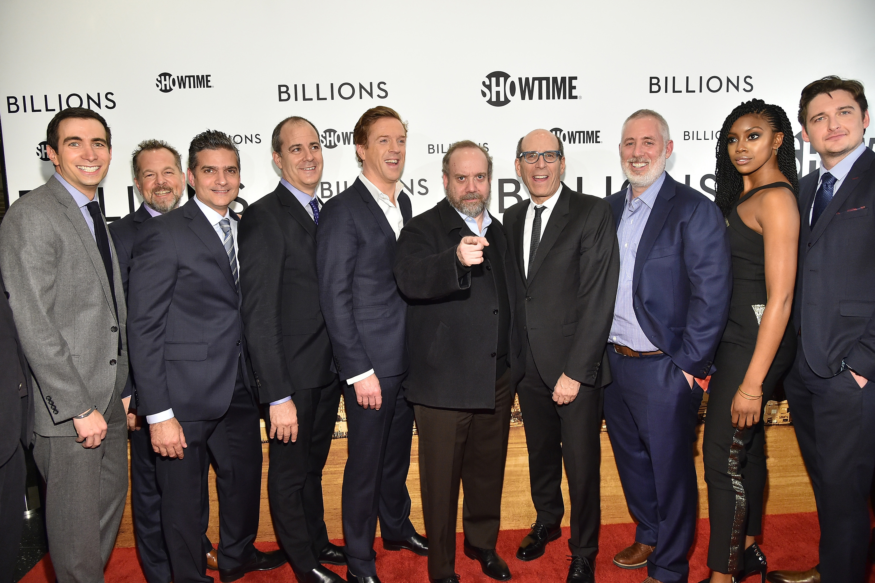 "(L-R) Andrew Ross Sorkin, David Costabile, David Levien, David Nevins, Damian Lewis, Paul Giamatti, Matthew C. Blank, Brian Koppelman, Condola Rashad, and Toby Leonard Moore attend the Showtime series premiere of ""Billions""."