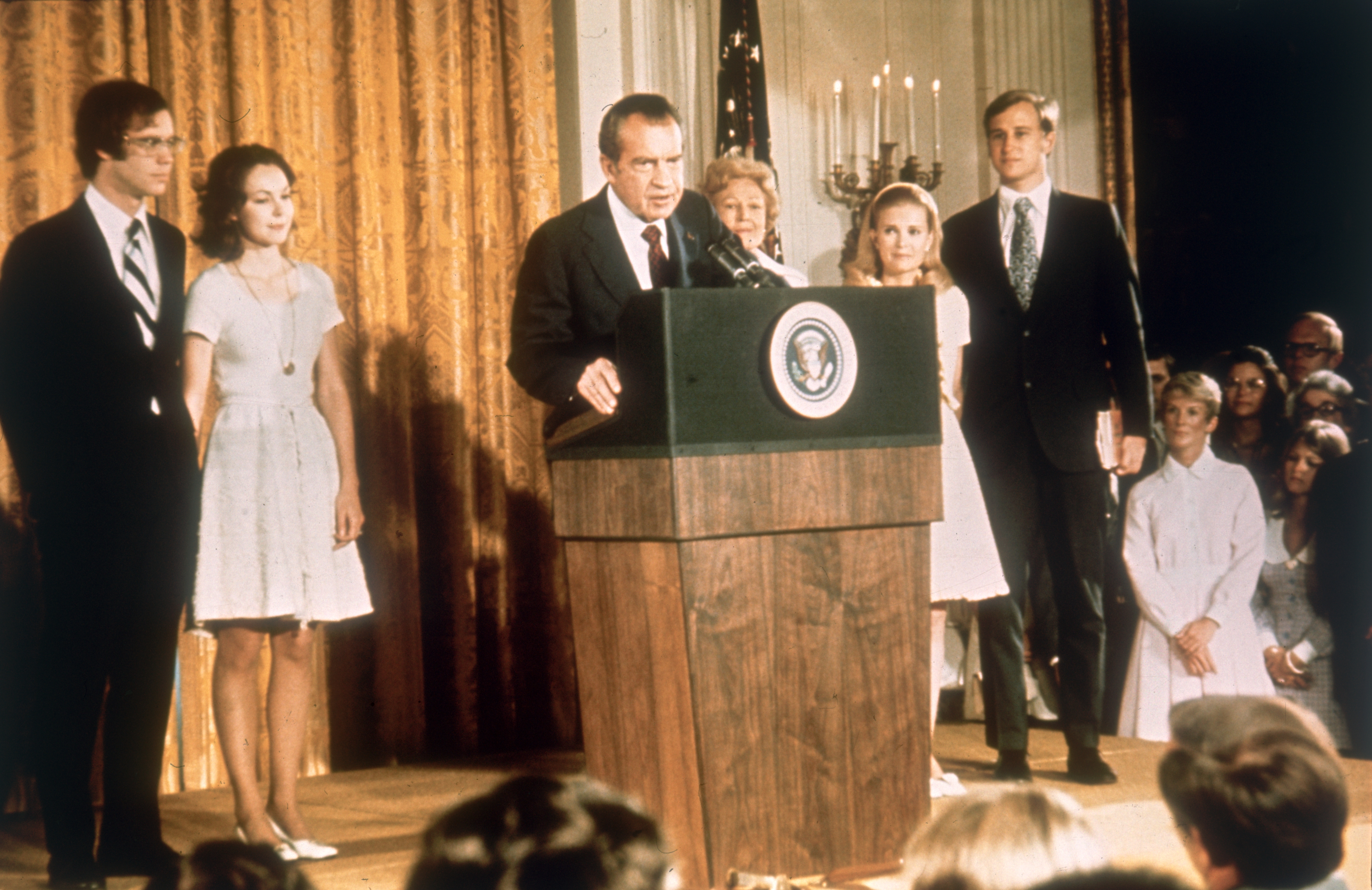 American politician Richard Nixon (1913 - 1994) at the White House with his family after his resignation as President, 9th August 1974. From left, son-in-law David Eisenhower, Julie Nixon-Eisenhower, Richard Nixon, Pat Nixon (1912 - 1993), Tricia Nixon and her husband Edward Cox, August 1974.