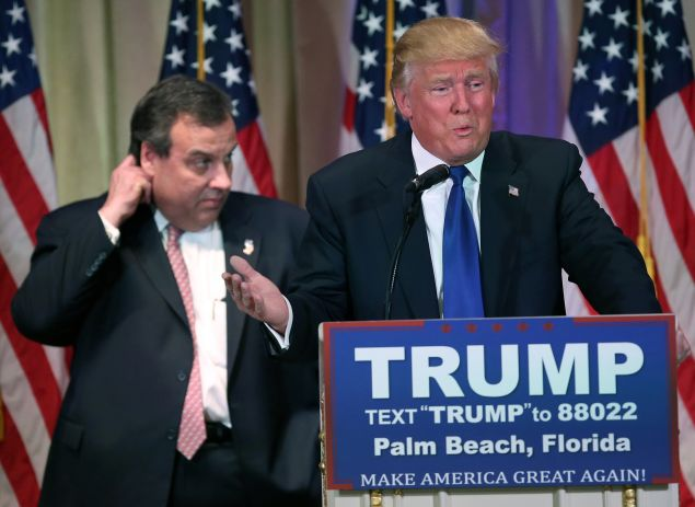 PALM BEACH, FL - MARCH 01: New Jersey Governor Chris Christie accompanies Republican Presidential frontrunner Donald Trump on the stage at a press conference on March 1, 2016 in Palm Beach, Florida. Christie stood by, often distracted, as Trump held a press conference at his Mar a Lago Club after the polls closed on Super Tuesday.