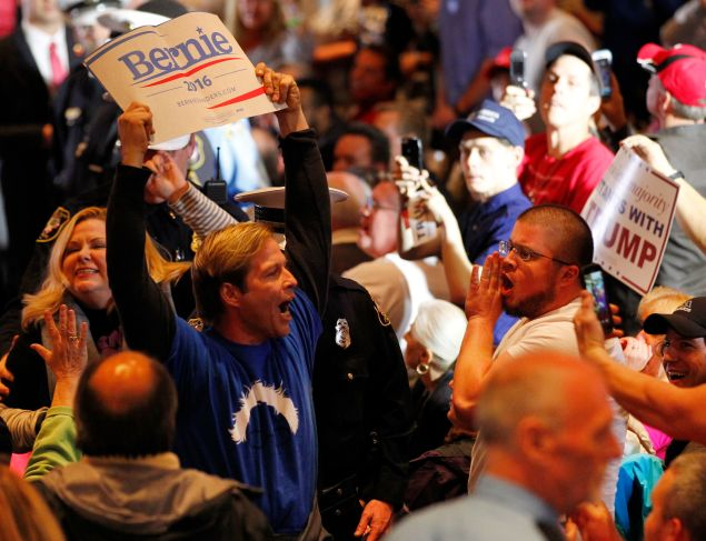 Sen. Bernie Sanders supporters clash with Donald Trump fans at a rally.
