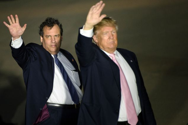 New Jersey Governor Chris Christie (L) and US Republican presidential hopeful Donald Trump (R) depart a rally March 14, 2016 in Vienna Center, Ohio.