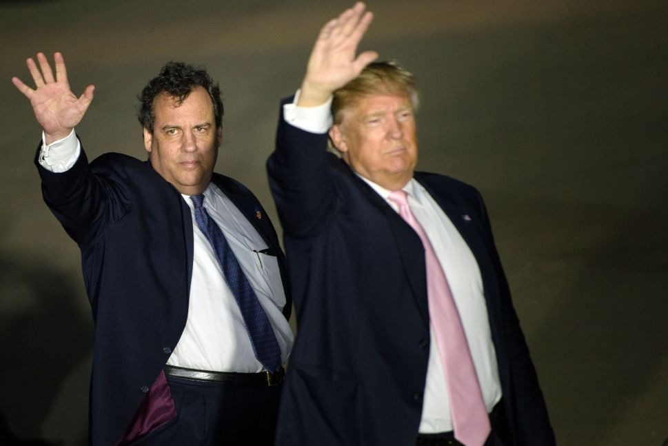 Chris Christie and Donald Trump (R) depart a rally March 14, 2016 in Vienna Center, Ohio.
