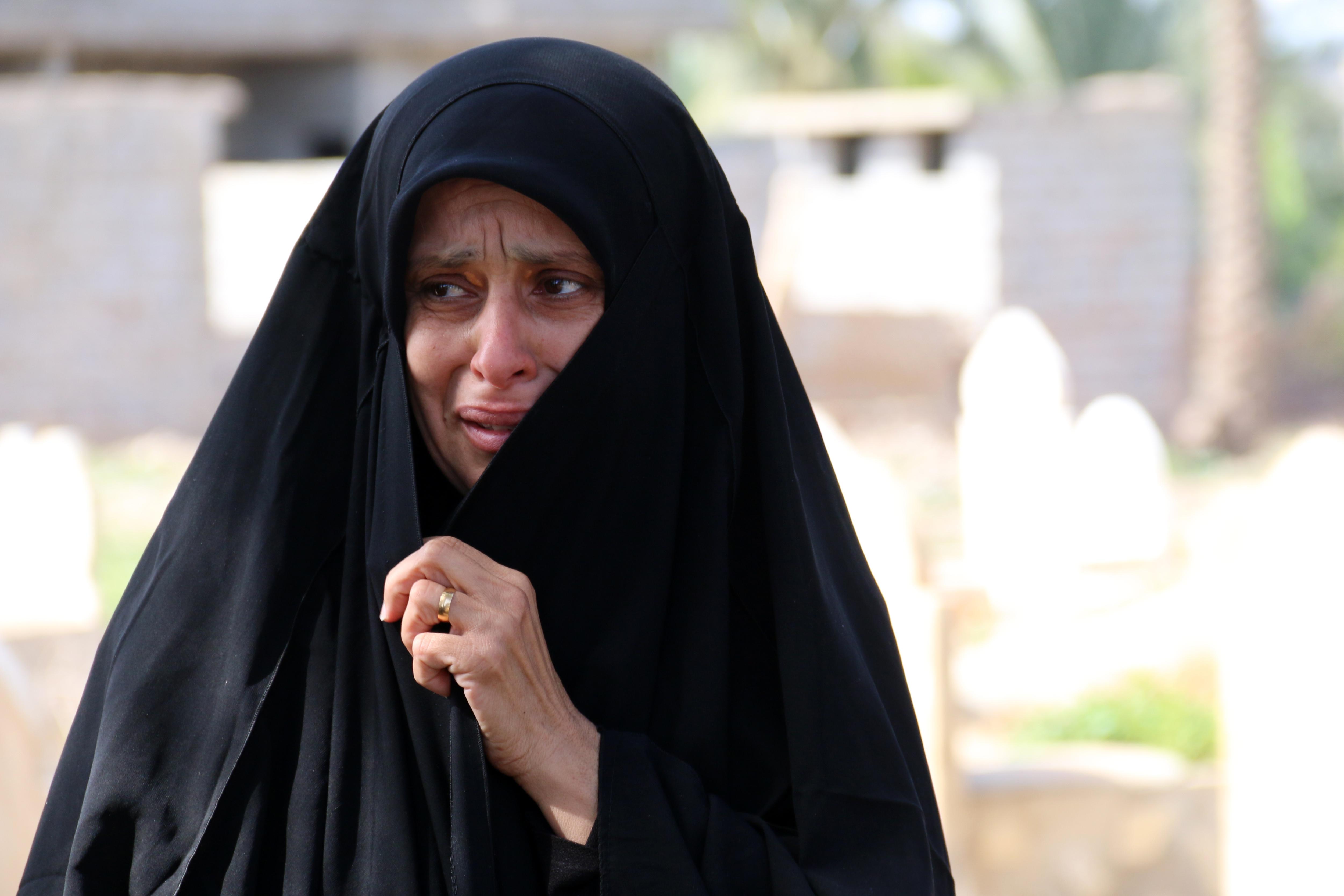 An Iraqi woman mourns during the funeral of Fatima Samir.