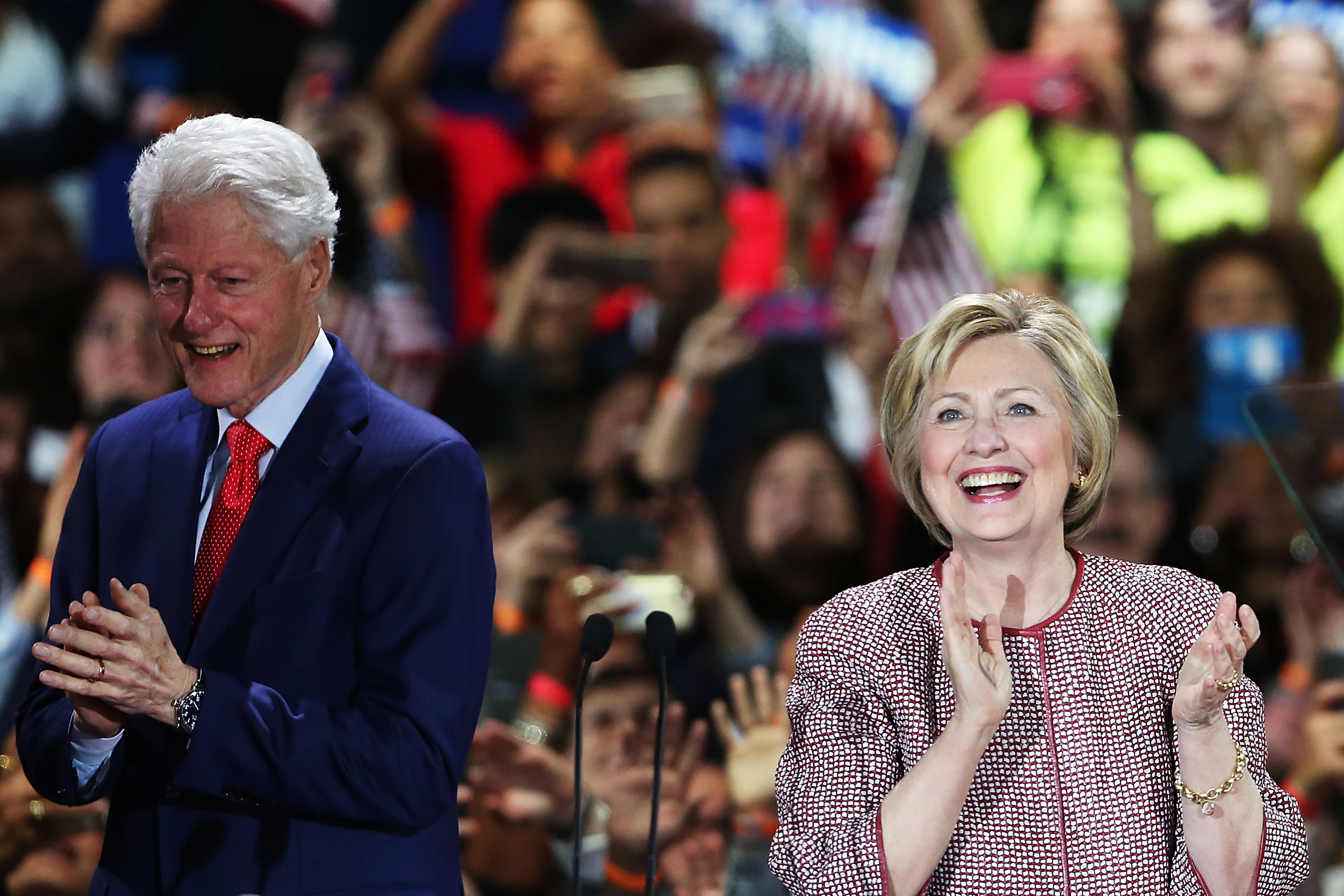 Democratic presidential candidate Hillary Clinton walks on stage with her husband Bill Clinton after winning the highly contested New York primary on April 19, 2016 in New York City. Clinton, who had enjoyed a large lead over her rival Bernie Sanders only months ago, saw that lead shrink as the Sanders campaign made inroads with younger and more liberal voters.