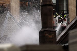 Firefighters fight the blaze at the Serbian Orthodox Cathedral of St. Sava