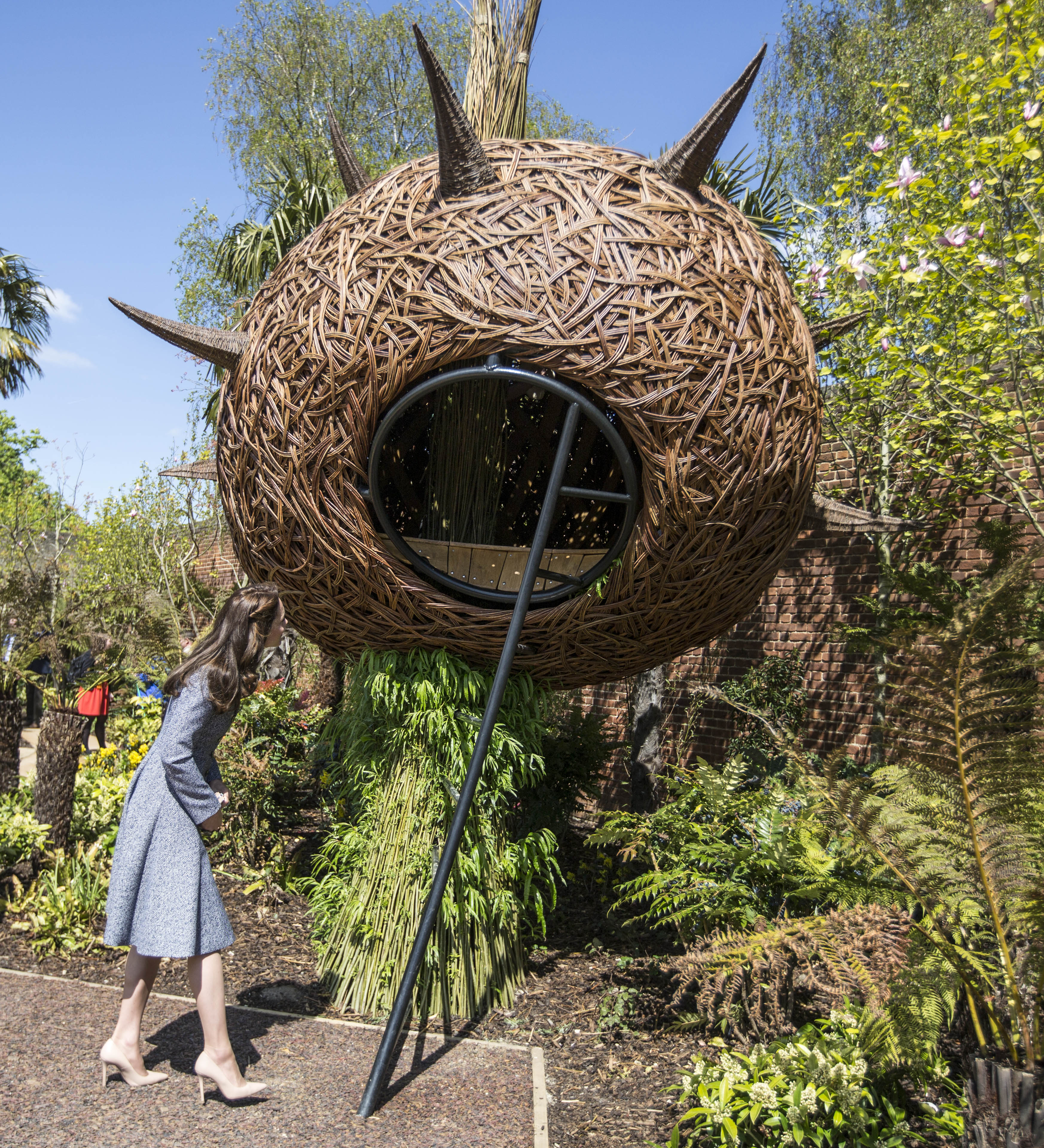 """LONDON, ENGLAND - MAY 04: Catherine, Duchess of Cambridge looks at a """"Dragons nest"""" play area as she officially opens The Magic Garden at Hampton Court Palace on May 4, 2016 in London, England. (Photo by Ri"""