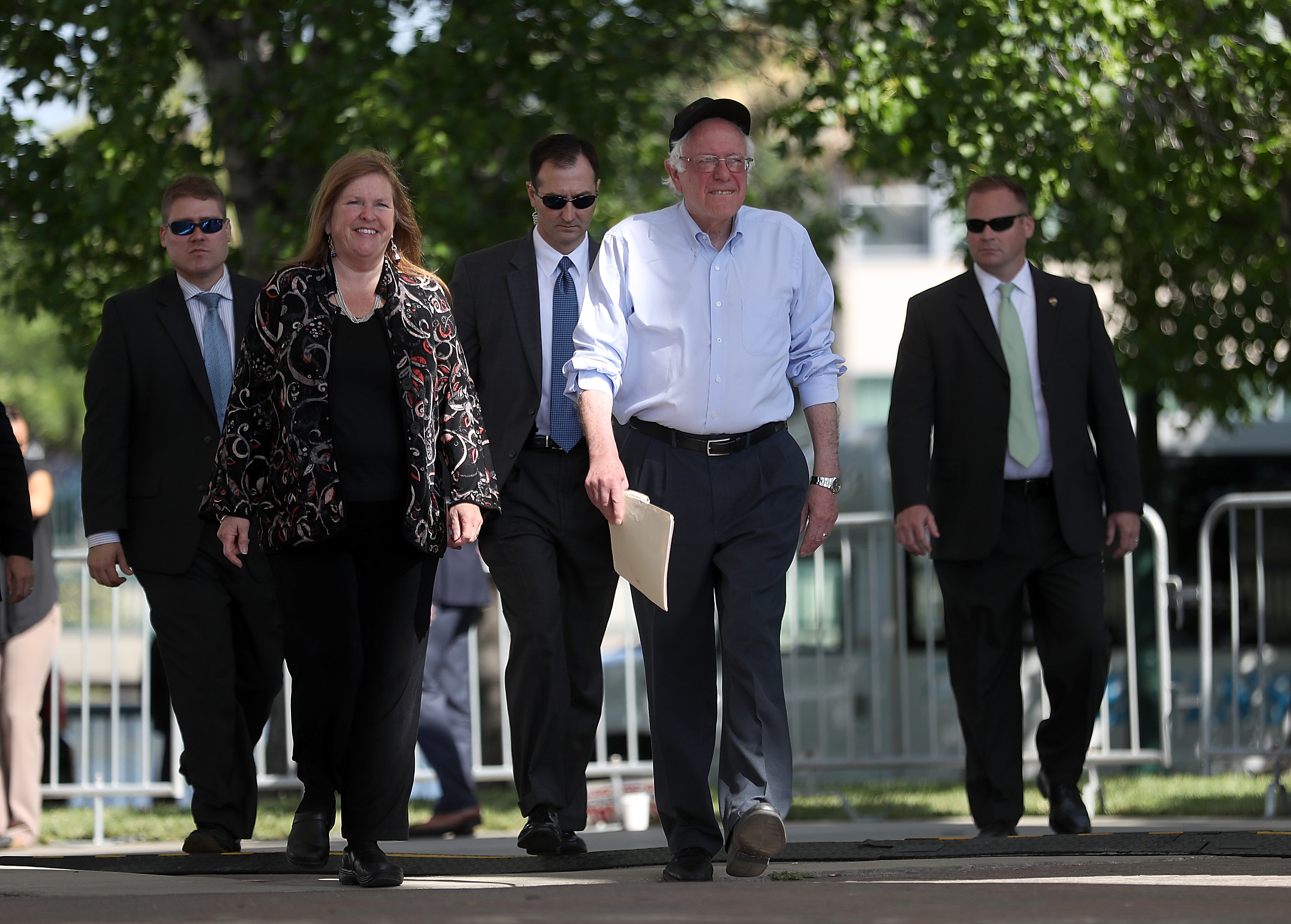 Democratic presidential candidate Sen.Bernie Sanders (D-VT) (2nd R) and his wife Jane O'Meara Sanders arrive at a campaign rally on May 10, 2016 in Stockton, California. Sanders is campaigning in California ahead of the state's June 7th presidential primary.