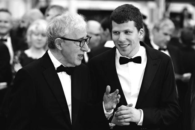 """Woody Allen talks with Jesse Eisenberg as they arrive for the screening of the film """"Cafe Society"""" during the opening ceremony of the 69th Cannes Film Festival."""
