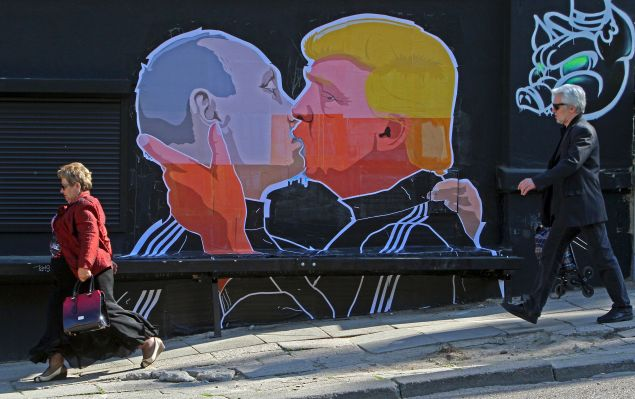 A mural on a restaurant wall in Vilnius depicts U.S. Presidential candidate Donald Trump and Russian President Vladimir Putin kissing.