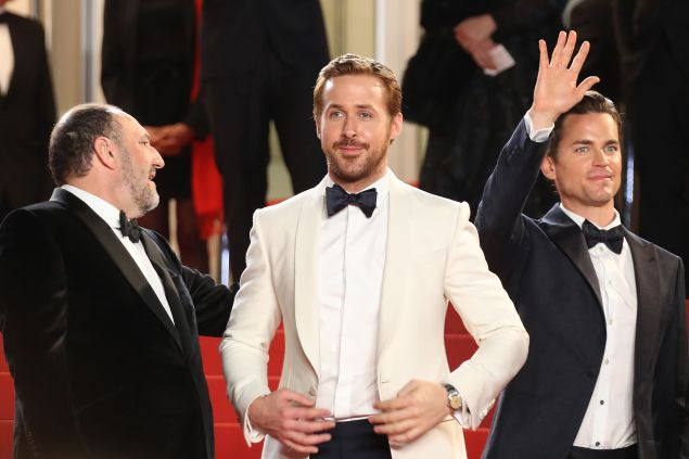 Ryan Gosling steals the scene in a white suit jacket
