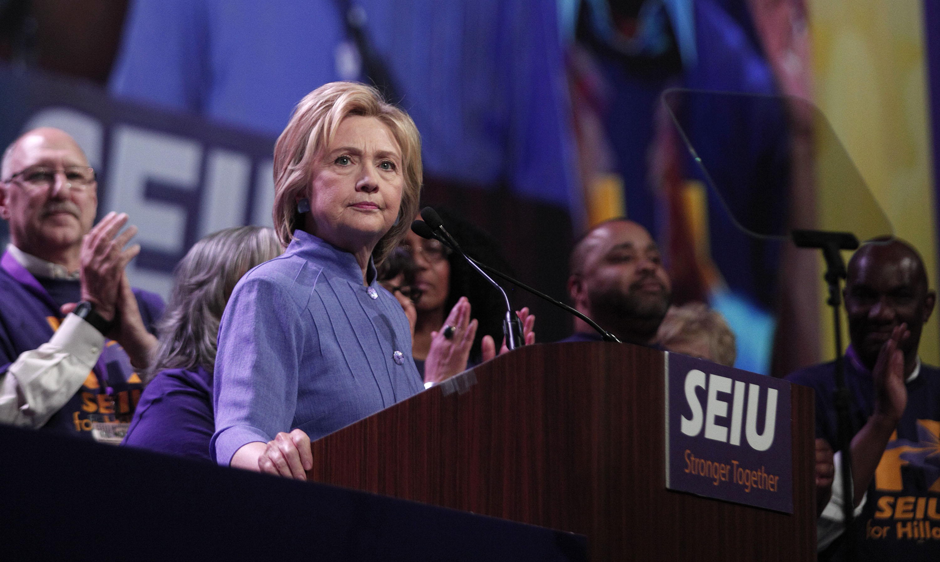 Democratic presidential candidate Hillary Clinton speaks at the Service Employees International Union (SEIU) 2016 International Convention at Cobo Center May 23, 2016 in Detroit, Michigan. Recent polls show Clinton in a tight race with Republican candidate Donald Trump.