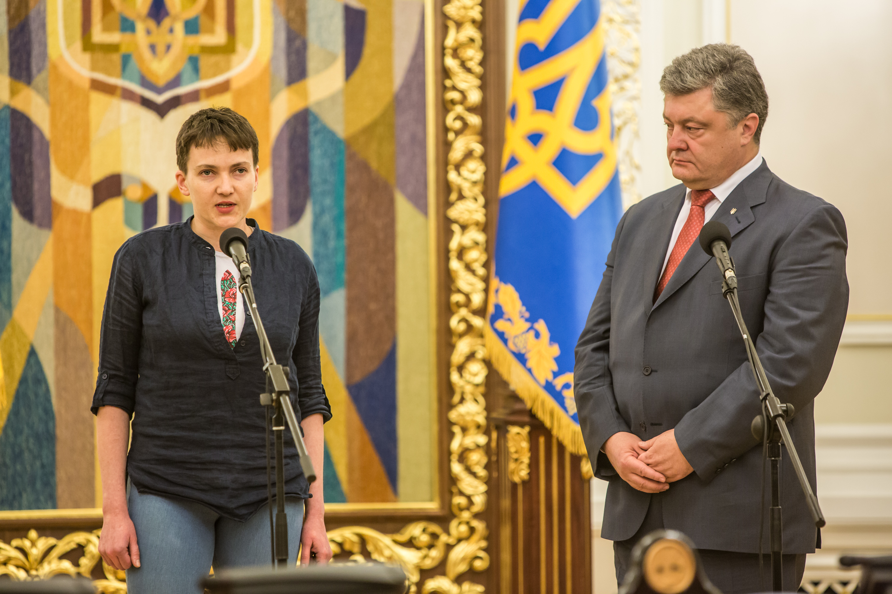Ukrainian military pilot Nadiya Savchenko (L) joins Ukrainian president Petro Poroshenko to address the media at the Presidential Administration building following Savchenko's return to Ukraine on May 25, 2016 in Kiev, Ukraine. Savchenko was captured while fighting Russia-backed rebels in eastern Ukraine and put on trial in Russia on charges that she was complicit in the deaths of two Russian journalists. She was elected to the Ukrainian parliament under Tymoshenko's Fatherland party while being held in Russia, and in March she was convicted of murder and sentenced to 22 years in prison, but was reportedly swapped for two Russian fighters captured by Ukrainian forces.