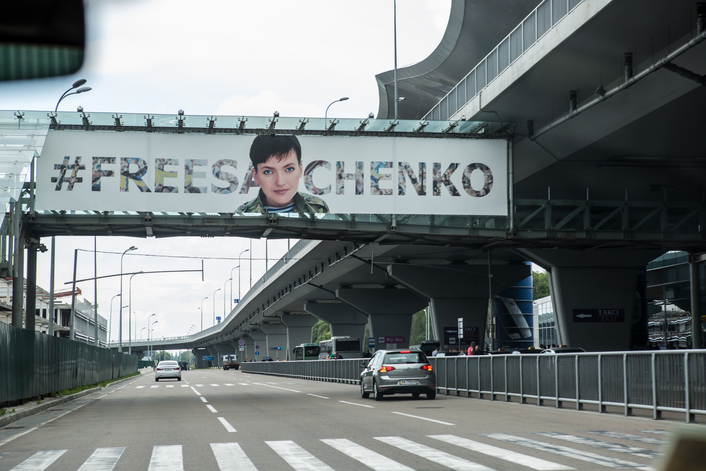 A sign advocating the release of Ukrainian military pilot Nadiya Savchenko hangs at Kyiv Boryspil Airport, where she landed after being released from Russian custody on May 25, 2016 in Boryspil, Ukraine. Savchenko was captured while fighting Russia-backed rebels in eastern Ukraine and put on trial in Russia on charges she was complicit in the deaths of two Russian journalists. In March she was convicted and sentenced to 22 years in prison, but was reportedly swapped for two Russian fighters captured by Ukrainian forces.