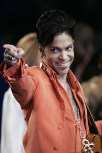 MIAMI BEACH, UNITED STATES: Recording star Prince performs during a press conference 01 February 2007 at the Super Bowl media center on Miami Beach, Florida. Prince will give the half-time performance at Super Bowl XLI 04 February 2007 when the Chicago Bears face the Indianapolis Colts. AFP PHOTO/ROBERT SULLIVAN (Photo credit should read ROBERT SULLIVAN/AFP/Getty Images)