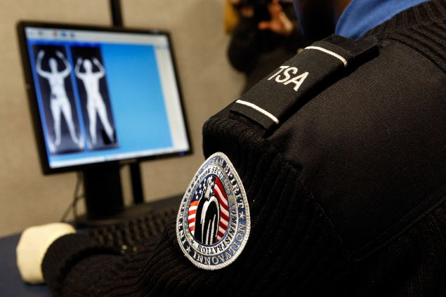 "Transportation Security Administration Security Officer Nyamsi Tchapleu looks at images created by a ""backscatter"" scanner."