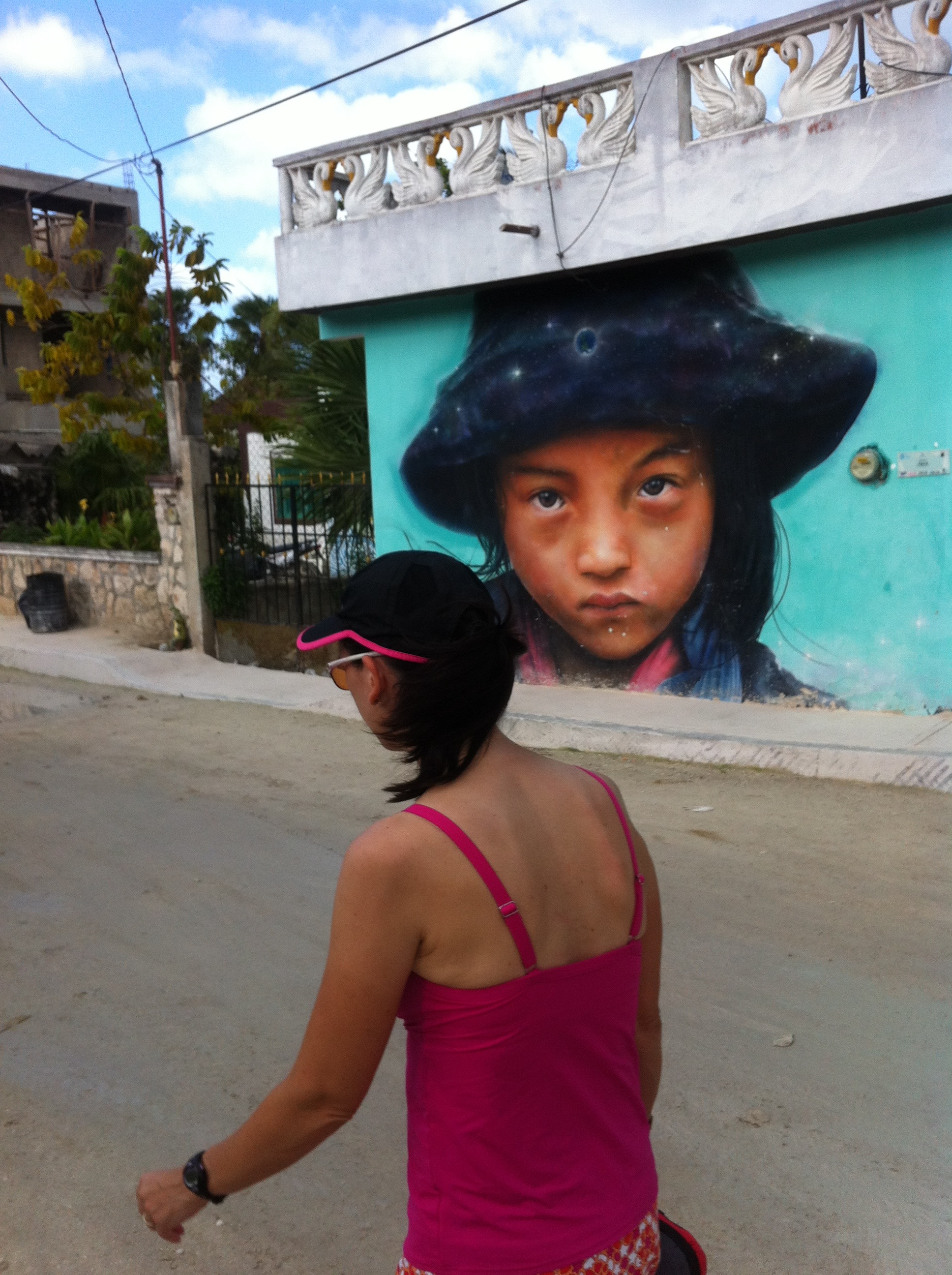 Murals decorate many buildings on the dusty streets of Isla Holbox.