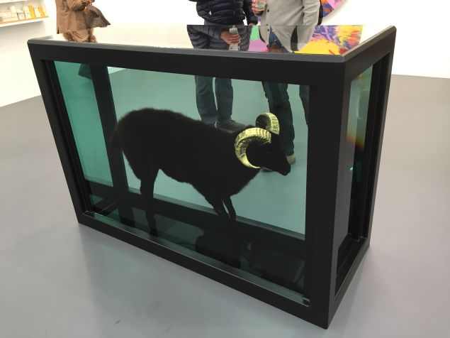Black Sheep with Golden Horns by Damien Hirst at Gagosian Gallery's booth.