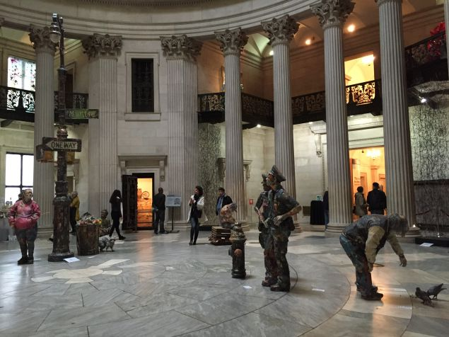 Visitors walk among sculptures by Will Kurtz in Federal Hall's rotunda at the inaugural Portal art fair.