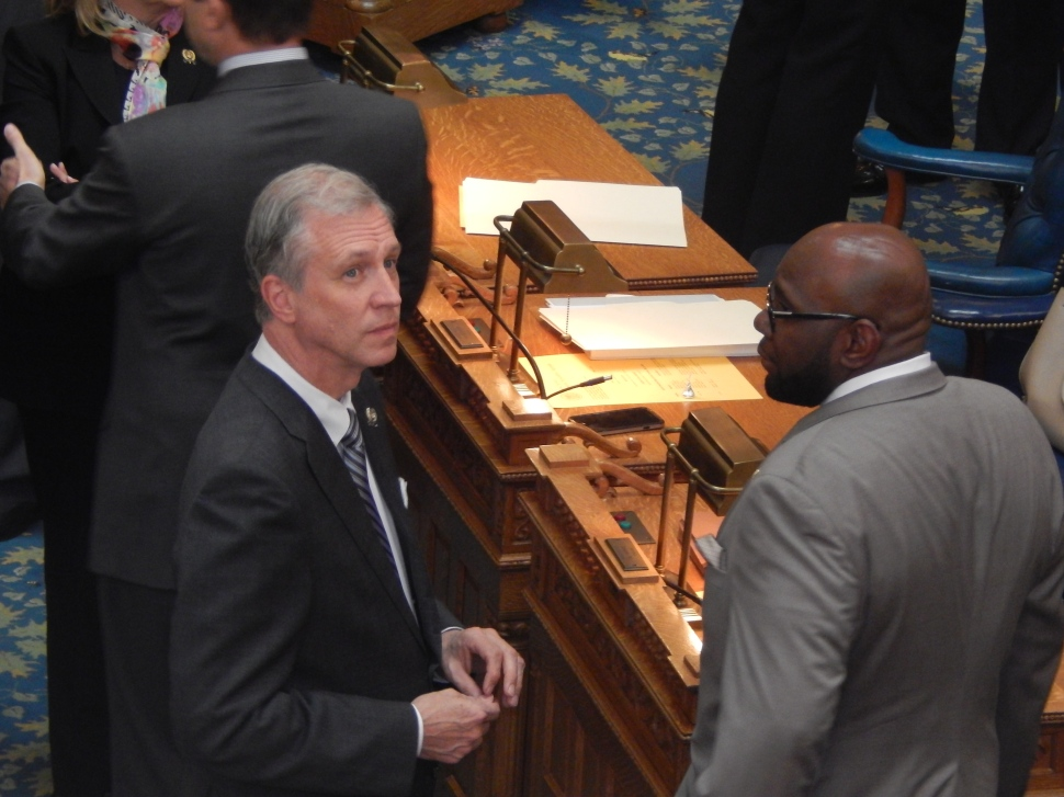 Assemblyman John Wisniewski, left, huddles up with Assemblyman Troy Singleton on the floor of the Assembly ahead of Thursday's session.