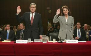 WASHINGTON - APRIL 14: FBI Director Robert Mueller (L) and the bureau's Executive Assistant Director for Intelligence Maureen Baginski are sworn in April 14, 2004 during the second day of the 10th public hearing on the performance of law enforcement and the intelligence community prior to September 11, 2001 attacks before the National Commission on Terrorist Attacks Upon the United States on Capitol Hill in Washington, DC. Mueller and Baginski defended the bureau's pre-Sept. 11 efforts on combating terrorism.