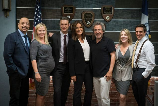The cast of Law & Order: SVU with Warren Leight.