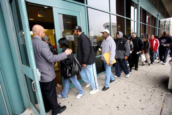 A security guard leads people into an unemployment center in Jersey City. NJ's job numbers are up this year, with 4.4 percent unemployment. (Photo: Jennifer Brown/The Star-Ledger)