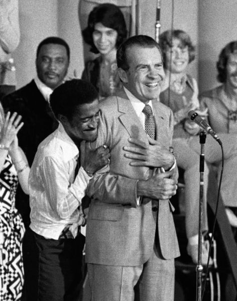 Entertainer Sammy Davis Jr. hugs President Richard Nixon at a youth rally in Miami, Aug. 22, 1972.
