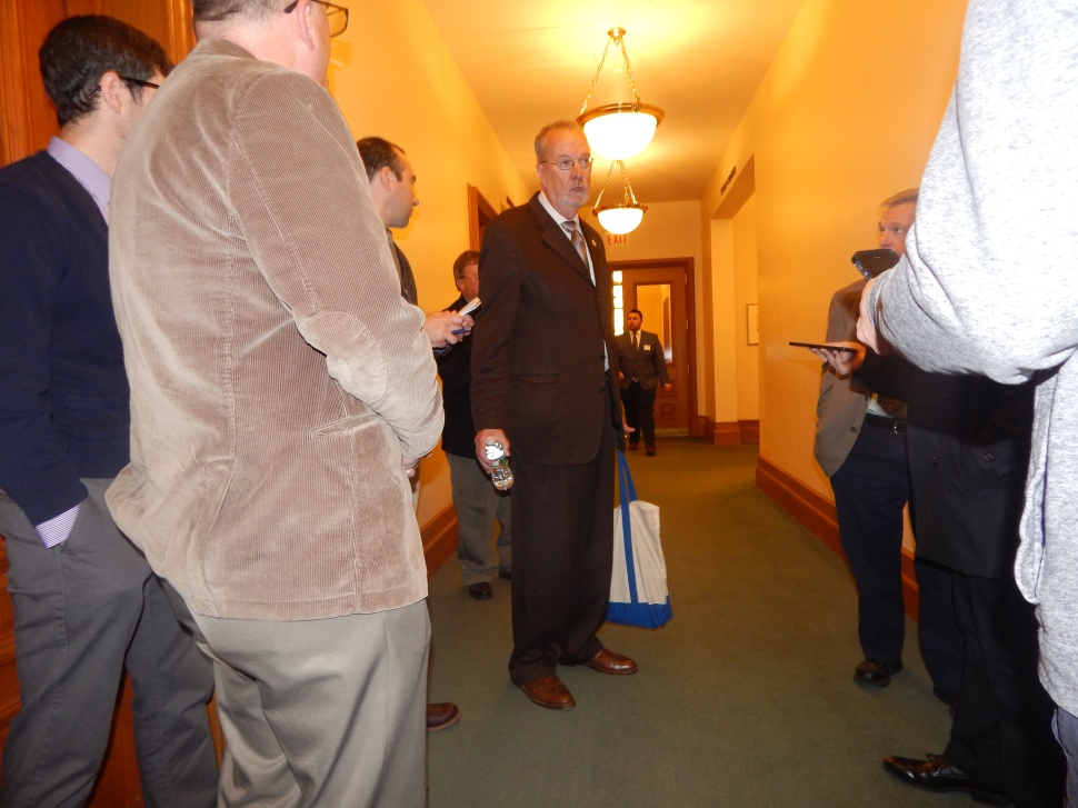 Senator Jim Whelan (D-2) talks to reporters today at the Statehouse. Photo by Carina M. Pizarro.