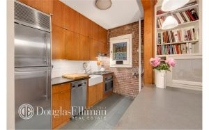 There's exposed brick, but of course.